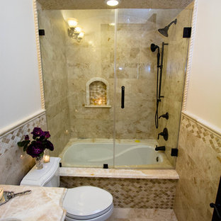 Design ideas for a medium sized mediterranean shower room bathroom in Los Angeles with raised-panel cabinets, beige cabinets, an alcove bath, a shower/bath combination, a one-piece toilet, beige tiles, brown tiles, porcelain tiles, white walls, marble flooring, a submerged sink and marble worktops.