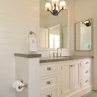 Medium sized classic family bathroom in Los Angeles with beaded cabinets, white cabinets, white tiles, metro tiles, white walls, a submerged sink, limestone worktops, beige floors and grey worktops.