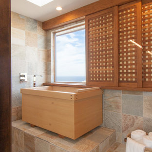 This is an example of an asian bathroom in Orange County with a japanese tub, an open shower and slate floors.