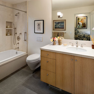 Example of a tuscan bathroom design in Santa Barbara with a wall-mount toilet