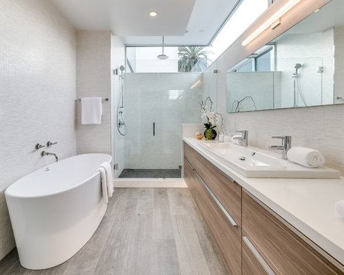 example of a mid sized trendy master white tile and glass tile porcelain floor and - Bathroom Designs With Freestanding Tubs
