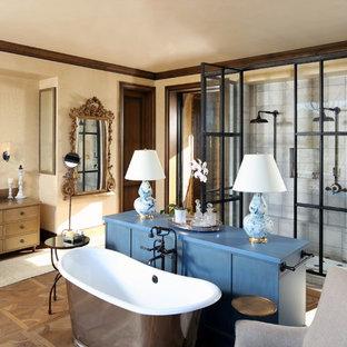 Bathroom - mediterranean master beige floor bathroom idea in Other with furniture-like cabinets, medium tone wood cabinets, beige walls, a vessel sink, wood countertops and a hinged shower door