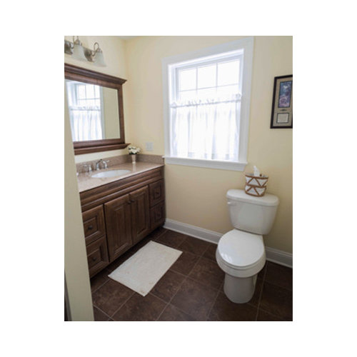 bathroom in other with recessed panel cabinets brown cabinets
