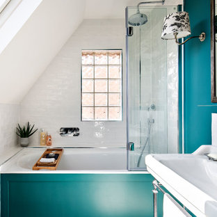 Design ideas for a traditional shower room in London with open cabinets, an alcove bath, a shower/bath combination, white tiles, green walls, a wall-mounted sink, an open shower and white worktops.
