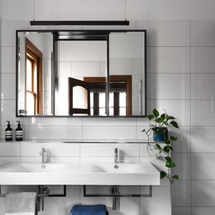 Transitional master bathroom in Melbourne with flat-panel cabinets, white cabinets, white tile, white walls, an integrated sink, multi-coloured floor, white benchtops, a double vanity and a floating vanity.
