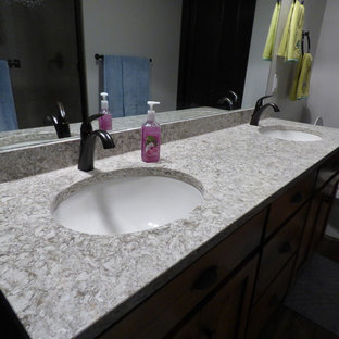 Example of a large trendy bathroom design in Other with raised-panel cabinets and engineered quartz countertops