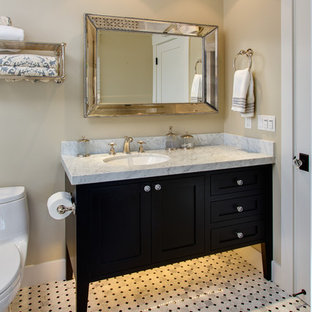 Bathroom - mid-sized craftsman 3/4 black and white tile and gray tile linoleum floor bathroom idea in San Francisco with shaker cabinets, black cabinets, a two-piece toilet, beige walls, an undermount sink and marble countertops
