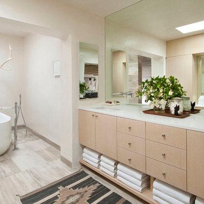 Freestanding bathtub - southwestern freestanding bathtub idea in Albuquerque with white countertops