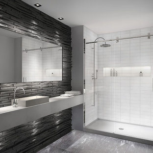Inspiration for a medium sized modern ensuite bathroom in London with a pedestal sink, limestone worktops, an alcove shower, grey tiles, stone slabs, white walls and limestone flooring.