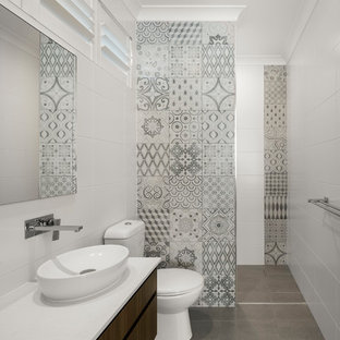Inspiration for a contemporary 3/4 bathroom in Brisbane with flat-panel cabinets, dark wood cabinets, an alcove shower, a one-piece toilet, gray tile, white tile, white walls, a vessel sink, grey floor, an open shower and white benchtops.