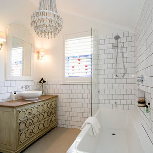 Bathroom - beach style 3/4 white tile bathroom idea in Brisbane with furniture-like cabinets, white walls and a vessel sink
