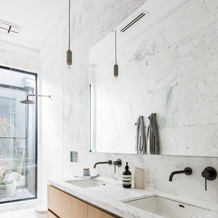 Small contemporary master wet room bathroom in Melbourne with an undermount sink, marble benchtops, flat-panel cabinets, medium wood cabinets, gray tile, white tile, marble, marble floors, white floor and an open shower.