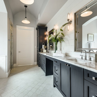 Example of a farmhouse master gray tile and white tile cement tile floor and gray floor bathroom design in Austin with shaker cabinets, black cabinets, gray walls, an undermount sink and a hinged shower door