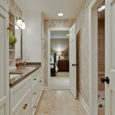 Example of a classic beige tile alcove shower design in Nashville with an undermount sink, white cabinets and recessed-panel cabinets