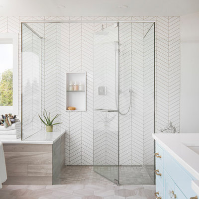 Inspiration for a large transitional master porcelain tile gray floor bathroom remodel in Calgary with recessed-panel cabinets, blue cabinets, white walls, an undermount sink, white countertops, quartz countertops, a hinged shower door and a niche