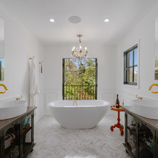Large tuscan master freestanding bathtub photo in Los Angeles with open cabinets, white walls and a vessel sink