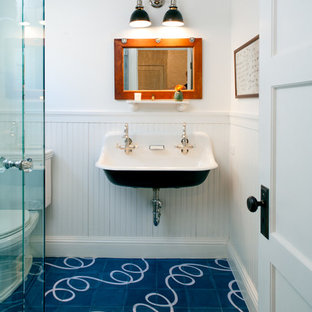 Example of a mid-sized farmhouse kids' ceramic floor and blue floor bathroom design in Los Angeles with a trough sink, a two-piece toilet and white walls