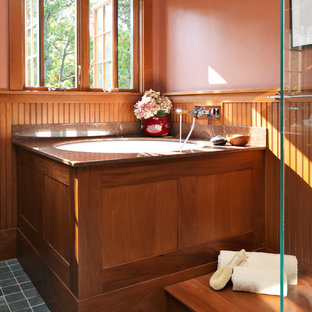 Inspiration for a craftsman master gray tile slate floor japanese bathtub remodel in Boston with orange walls
