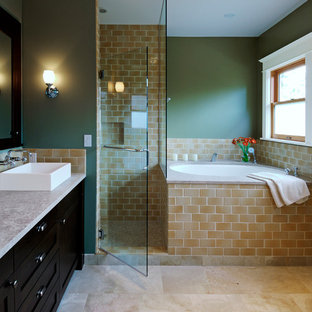 Photo of a traditional bathroom in Seattle with a vessel sink, shaker cabinets, dark wood cabinets, a corner shower, beige tile, green walls and a japanese tub.