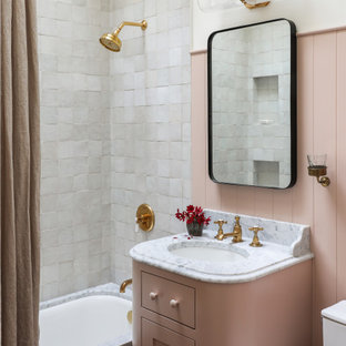 Photo of a traditional bathroom in Seattle with shaker cabinets, an undermount tub, a shower/bathtub combo, white tile, white walls, an undermount sink, a shower curtain, white benchtops, a single vanity and a built-in vanity.
