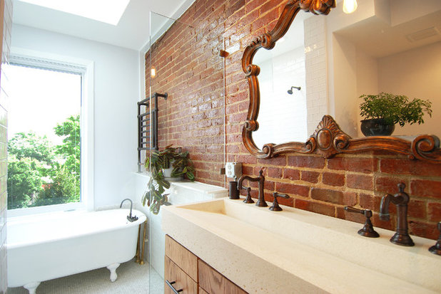 Transitional Bathroom by Impact Remodeling and Construction