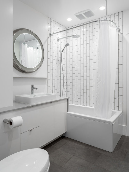 Mid Sized Trendy 3/4 White Tile And Subway Tile Porcelain Floor Bathroom  Photo