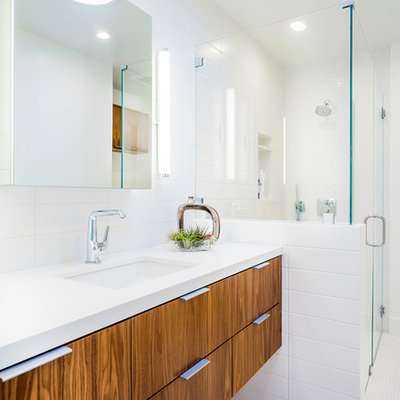 Corner shower - large contemporary white tile mosaic tile floor corner shower idea in Los Angeles with an undermount sink, flat-panel cabinets, medium tone wood cabinets and white walls