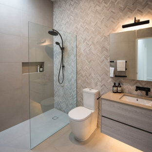 Inspiration for a small contemporary master bathroom in Melbourne with light wood cabinets, an open shower, multi-coloured tile, mosaic tile, grey walls, porcelain floors, an undermount sink, engineered quartz benchtops, grey floor, an open shower, grey benchtops and a two-piece toilet.