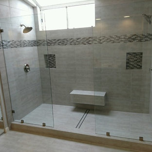 Example of a large minimalist master alcove shower design in San Diego