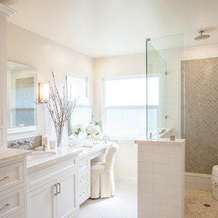 Large traditional master bathroom in San Diego with an undermount sink, recessed-panel cabinets, white cabinets, marble benchtops, a corner shower, white tile, ceramic tile and white walls.