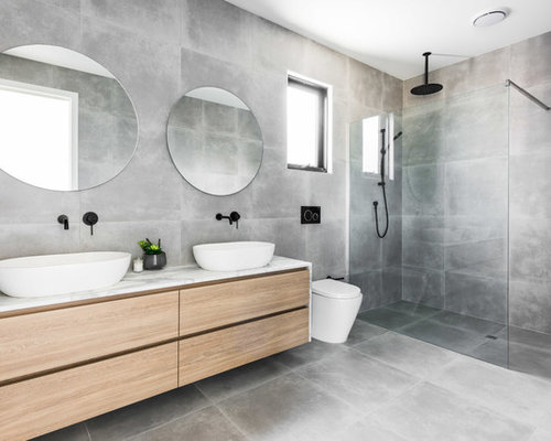 Inspiration for a mid sized modern master bathroom in melbourne with flat panel cabinets