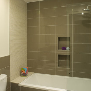 Example of a minimalist brown tile bathroom design in San Francisco with a two-piece toilet