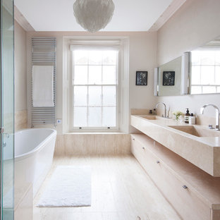 Mid-sized trendy marble floor freestanding bathtub photo in Surrey with beige walls, marble countertops and beige countertops