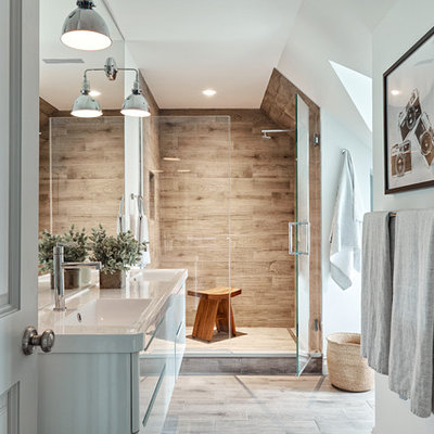 Mid-sized trendy master brown tile and porcelain tile porcelain tile and brown floor alcove shower photo in New York with flat-panel cabinets, white cabinets, white walls, an integrated sink, quartz countertops and a hinged shower door