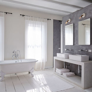 Example of a large trendy master painted wood floor claw-foot bathtub design in New York with a vessel sink and gray walls
