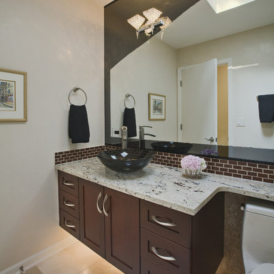Inspiration for a contemporary bathroom remodel in Chicago with a vessel sink