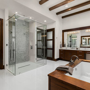 Bathroom - contemporary master gray tile porcelain tile and white floor bathroom idea in Orlando with flat-panel cabinets, yellow walls, an undermount sink, marble countertops, a hinged shower door, white countertops and medium tone wood cabinets