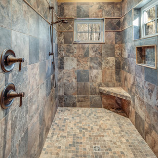 Inspiration for a mid-sized rustic 3/4 beige tile multicolored floor alcove shower remodel with shaker cabinets, medium tone wood cabinets, a one-piece toilet, beige walls, an undermount sink, a hinged shower door and beige countertops
