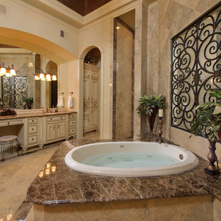 Inspiration For A Mediterranean Bathroom Remodel In Houston With A Hot Tub