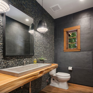 Inspiration for a mid-sized contemporary master medium tone wood floor and single-sink bathroom remodel in Seattle with a one-piece toilet and a vessel sink