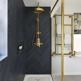 Example of a classic 3/4 corner shower design in London with black walls