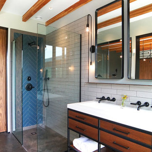 Bathroom - mid-century modern 3/4 blue tile, white tile and subway tile gray floor and concrete floor bathroom idea in New York with furniture-like cabinets, medium tone wood cabinets, gray walls and a trough sink