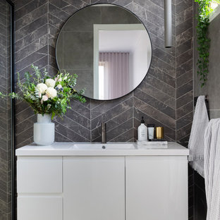 Design ideas for a mid-sized contemporary bathroom in Canberra - Queanbeyan with white cabinets, gray tile, porcelain tile, porcelain floors, an integrated sink, grey floor, flat-panel cabinets and white benchtops.