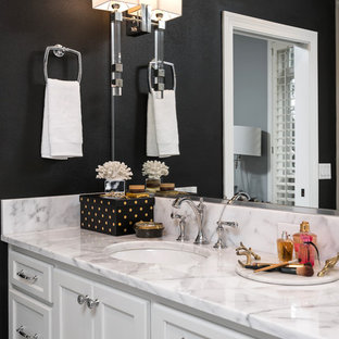 Example of a mid-sized transitional master black and white tile and mosaic tile mosaic tile floor bathroom design in Miami with flat-panel cabinets, white cabinets, a two-piece toilet, black walls, an undermount sink and marble countertops