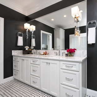 Bathroom - mid-sized transitional master black and white tile and mosaic tile mosaic tile floor bathroom idea in Miami with flat-panel cabinets, white cabinets, a two-piece toilet, black walls, an undermount sink and marble countertops