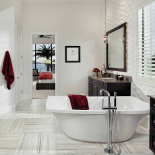 Large trendy master white tile and porcelain tile vinyl floor and white floor bathroom photo in San Diego with shaker cabinets, dark wood cabinets, white walls, an undermount sink, marble countertops and a hinged shower door