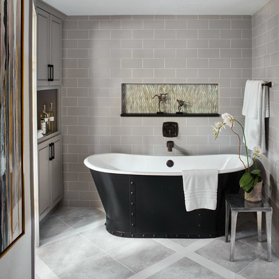 Inspiration for a transitional gray tile and subway tile freestanding bathtub remodel in Denver with recessed-panel cabinets and gray cabinets
