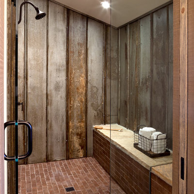 Mid-sized country gray tile and metal tile brick floor doorless shower photo in Denver with white walls