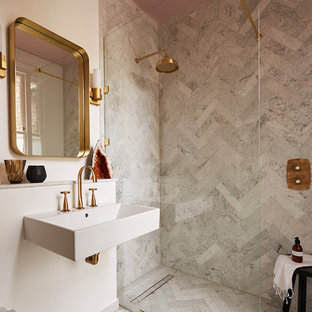 Inspiration for a medium sized contemporary bathroom in London with marble tiles, marble flooring, a wall-mounted sink, grey floors, a built-in shower, grey tiles, white walls and an open shower.