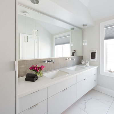 Inspiration for a mid-sized contemporary master gray tile and porcelain tile porcelain tile bathroom remodel in Toronto with an undermount sink, flat-panel cabinets, white cabinets, quartzite countertops, white walls and white countertops